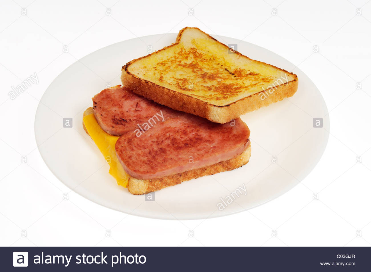 Toasted Hormel Spam sandwich with cheese on white plate on white 1300x953