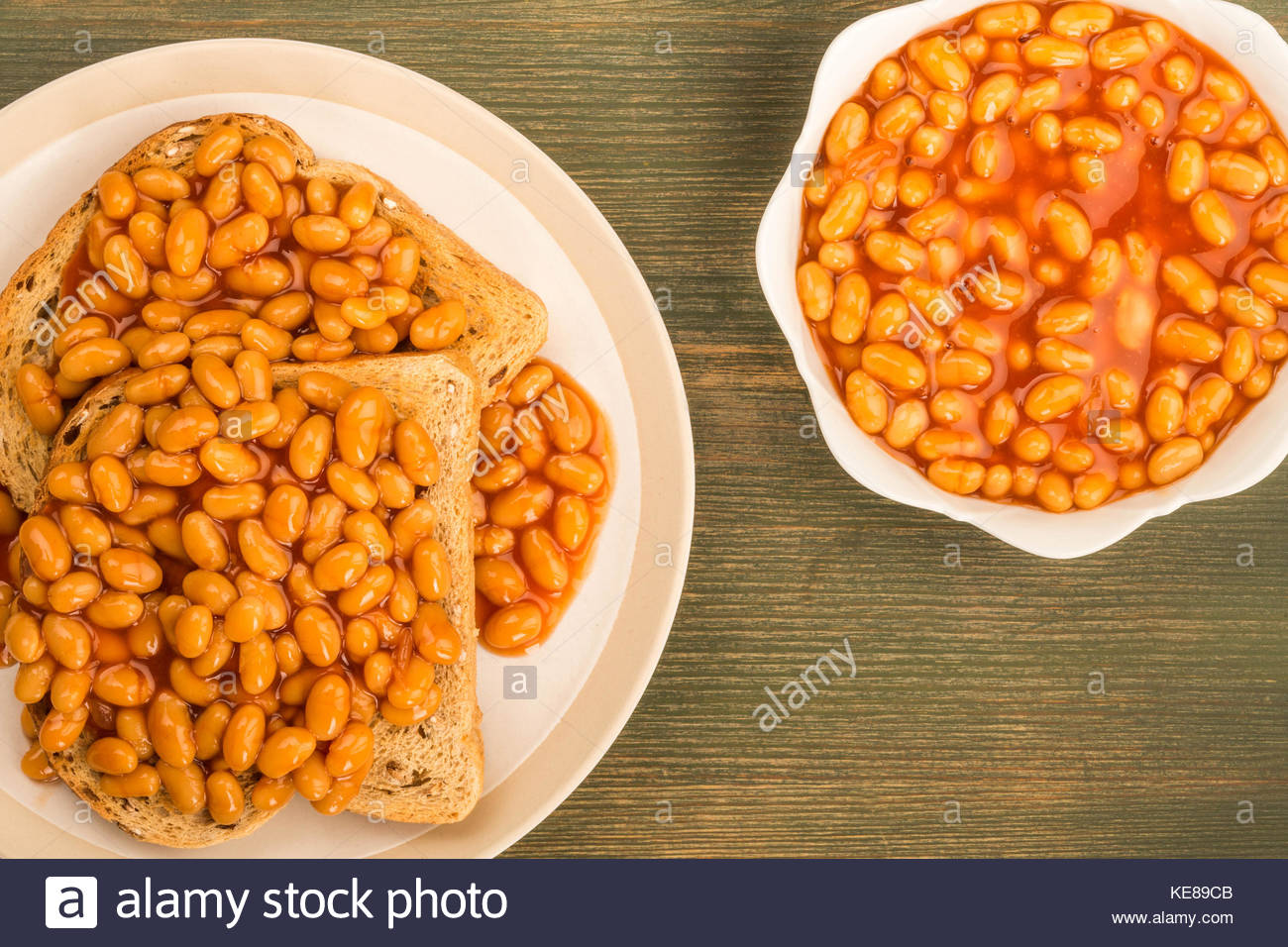 Baked Beans in Tomato Sauce on Toast On A Green Wooden Background 1300x956