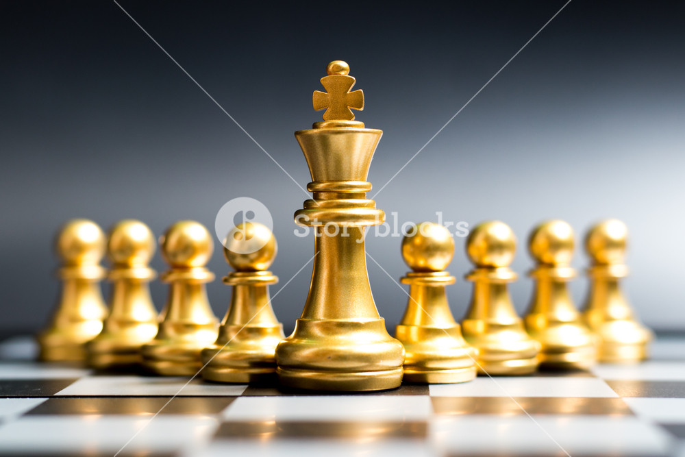 Gold king chess piece stand in front of pawn on black background 1000x667