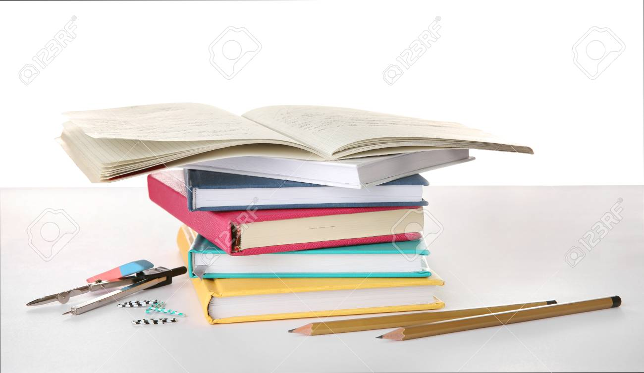 Stack Of Books And Stationery On White Background Doing Homework 1300x753