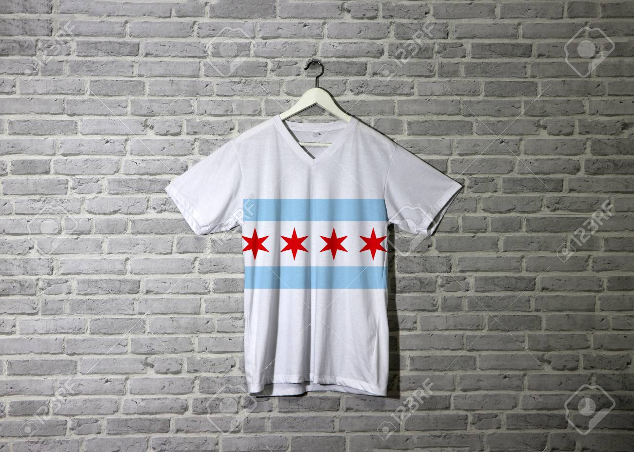 Chicago Flag On Shirt And Hanging On The Wall With Brick Pattern 1300x928