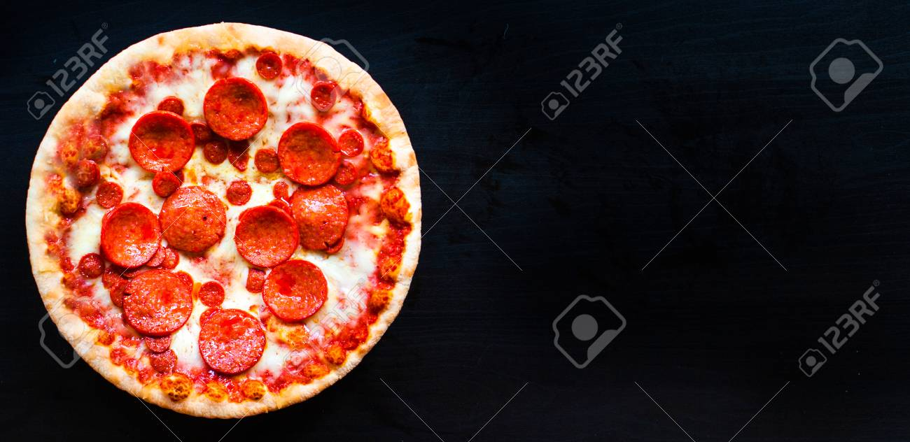 Delicious Italian Pizza On Black Concrete Background With 1300x632