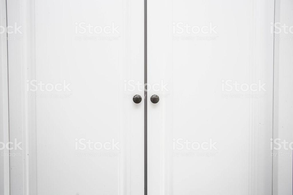 White Wooden Closet Doors Close Up Background Texture Stock Photo 1024x682