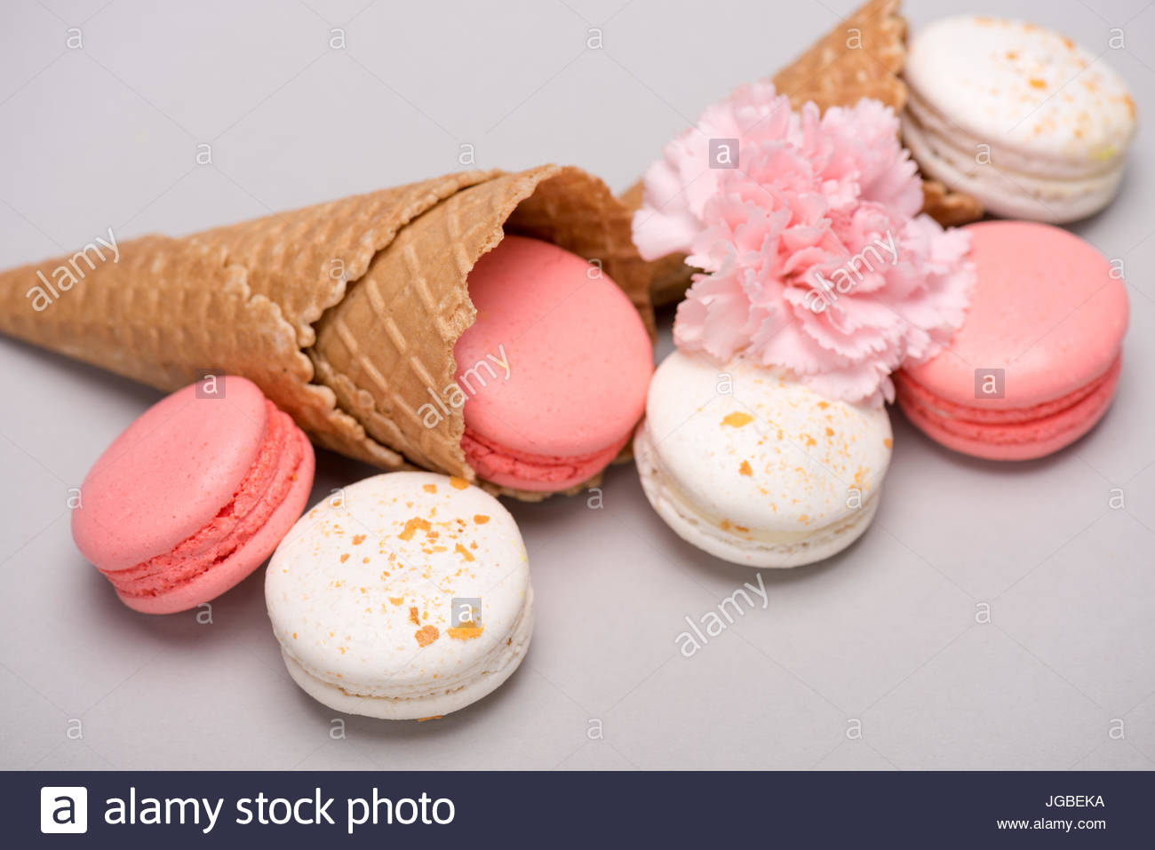 Group of pink and white macarons in waffle cones with Carnation 1300x957