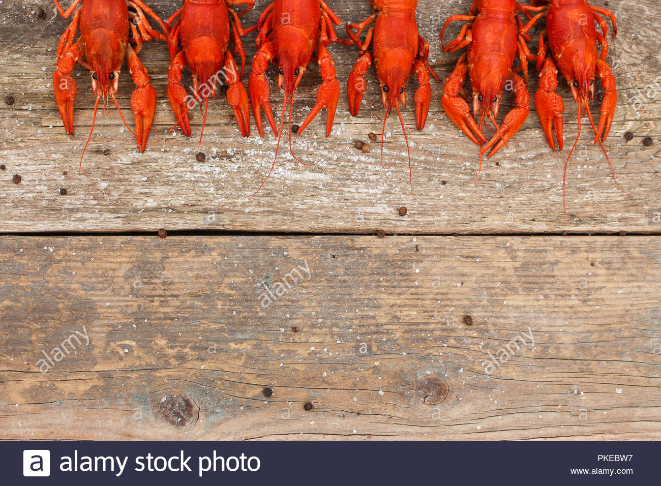 Crawfish on the old wooden background Top view Stock Photo 1300x956