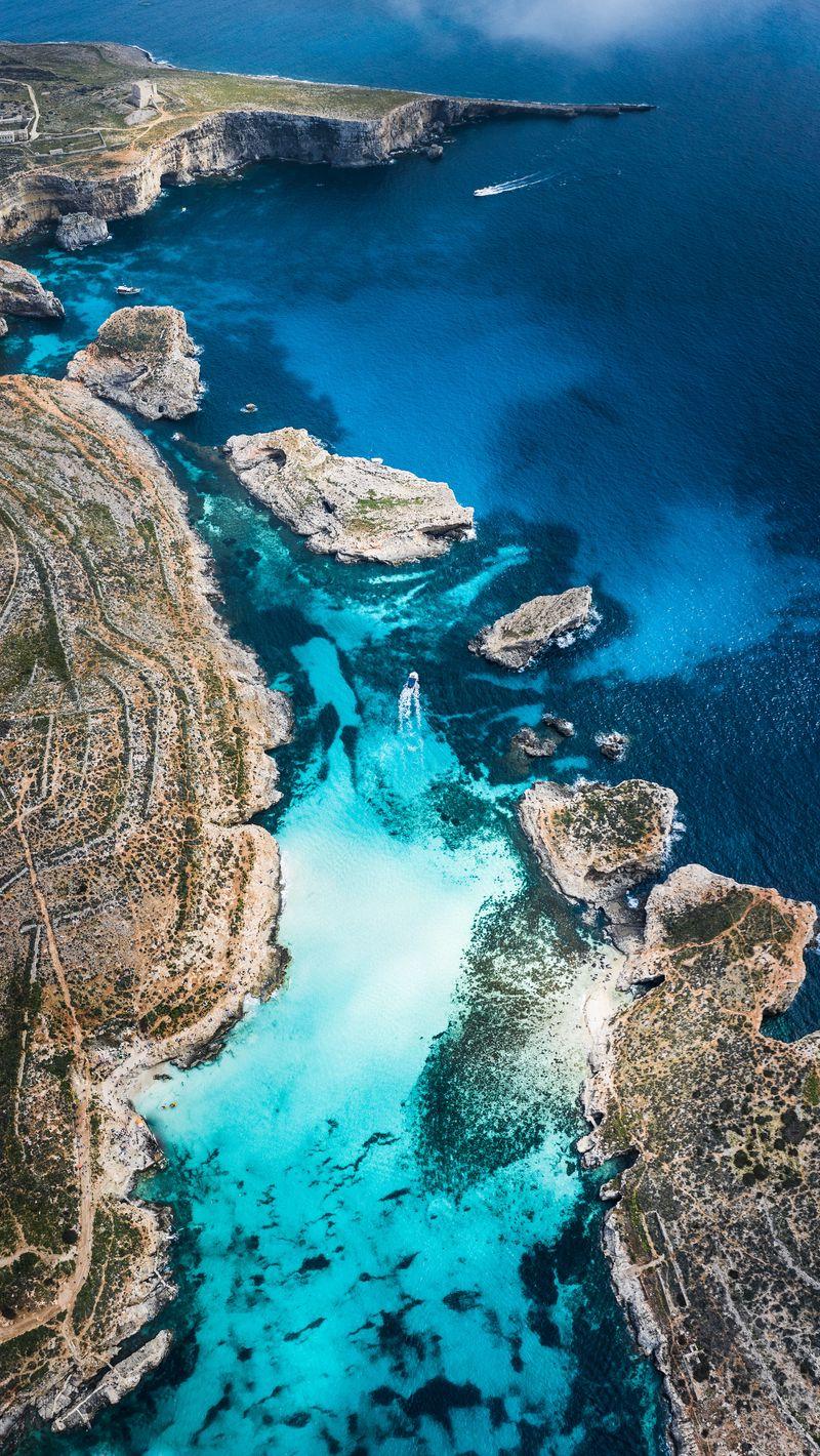 Download wallpaper 800x1420 bay coast stony ocean island 800x1420