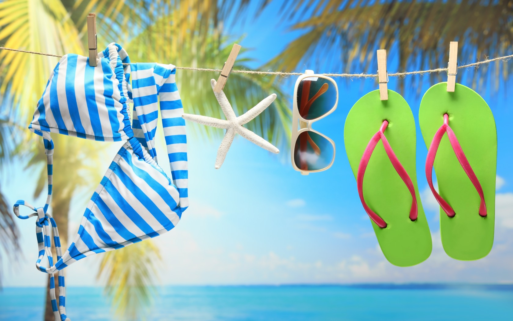 Swimwear Sunglasses And Green Flip Flops On The Beach wallpaper by 1680x1050