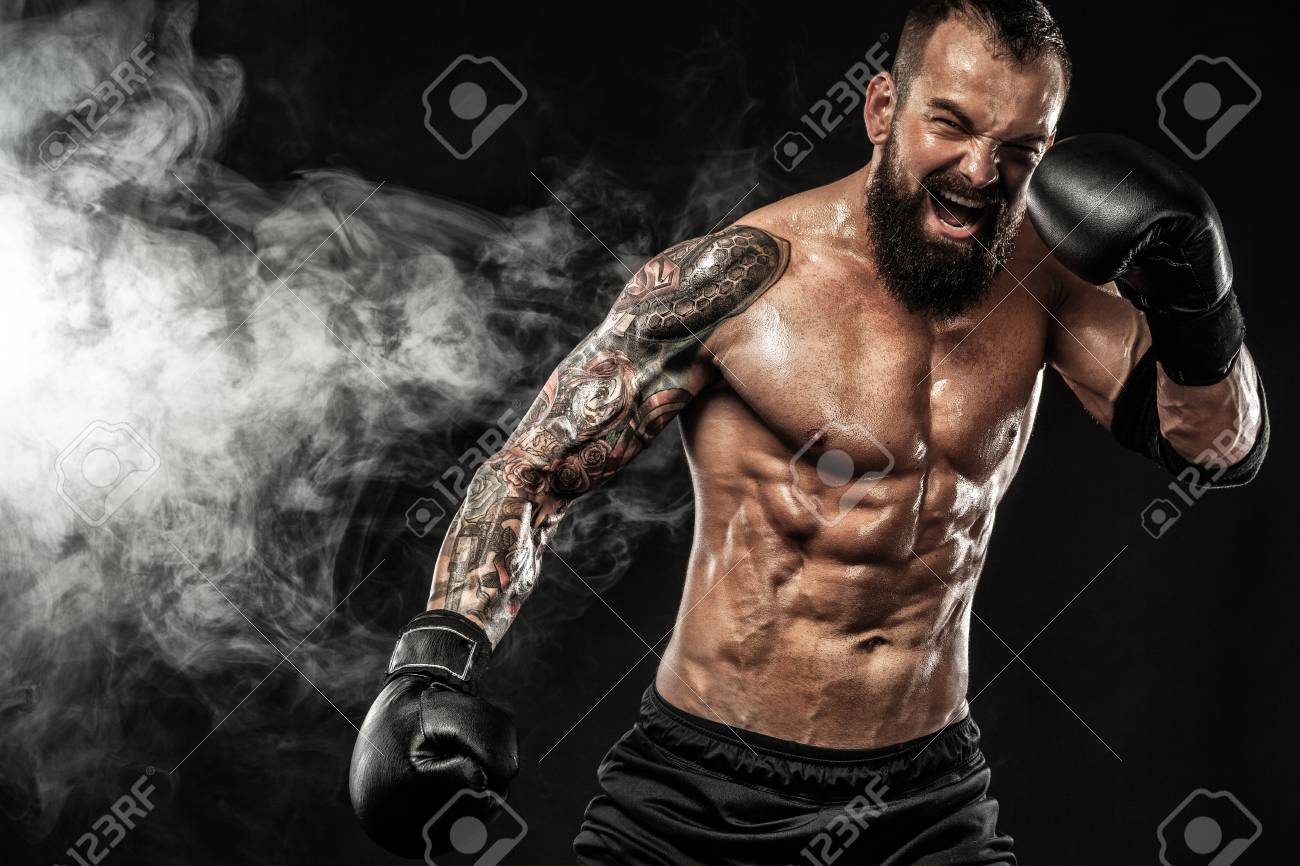 Sportsman Muay Thai Boxer Fighting On Black Background With Smoke 1300x866
