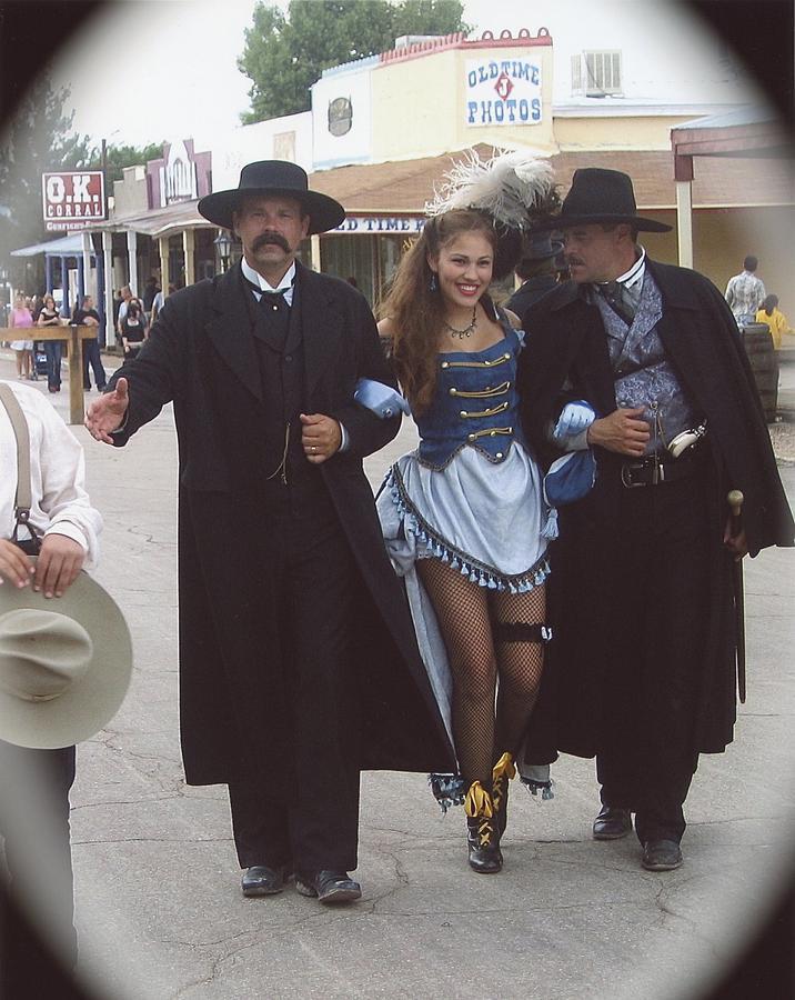 Wyatt Earp Doc Holliday Escort Show Girl Ok Corral In Background 716x900