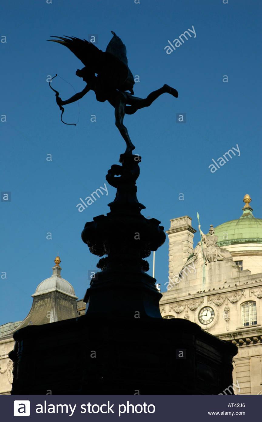 Silhouette of Eros statue with Britannia statue in the background 864x1390