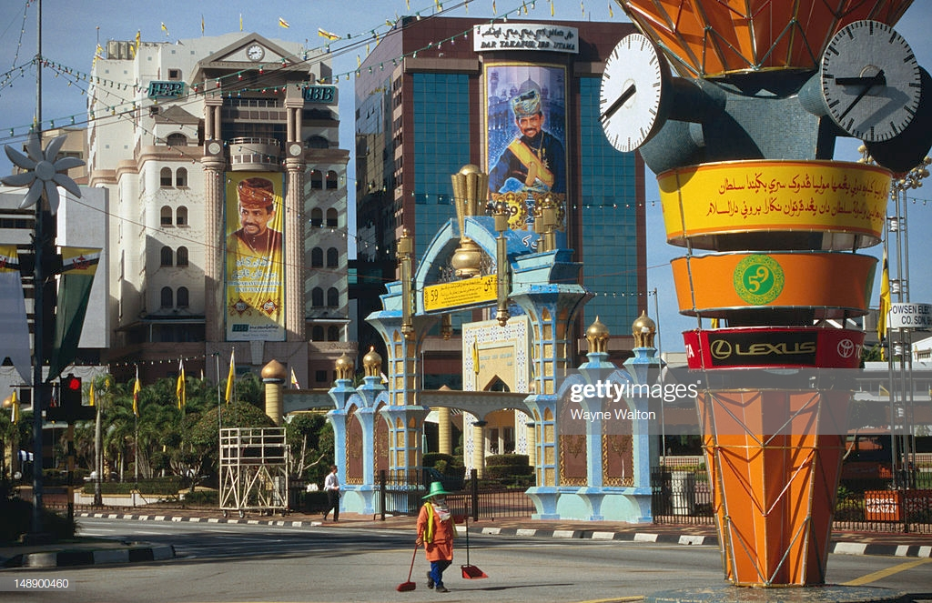 Street Sweeper By Clock Tower With City In Background Stock Photo 1024x663