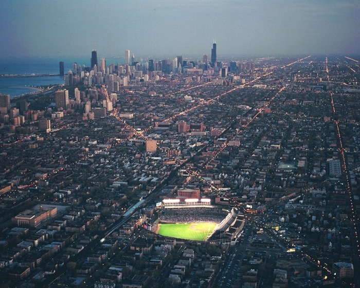 Photo of Aerial Of Wrigley Field Night Game Chicago Skyline 700x560