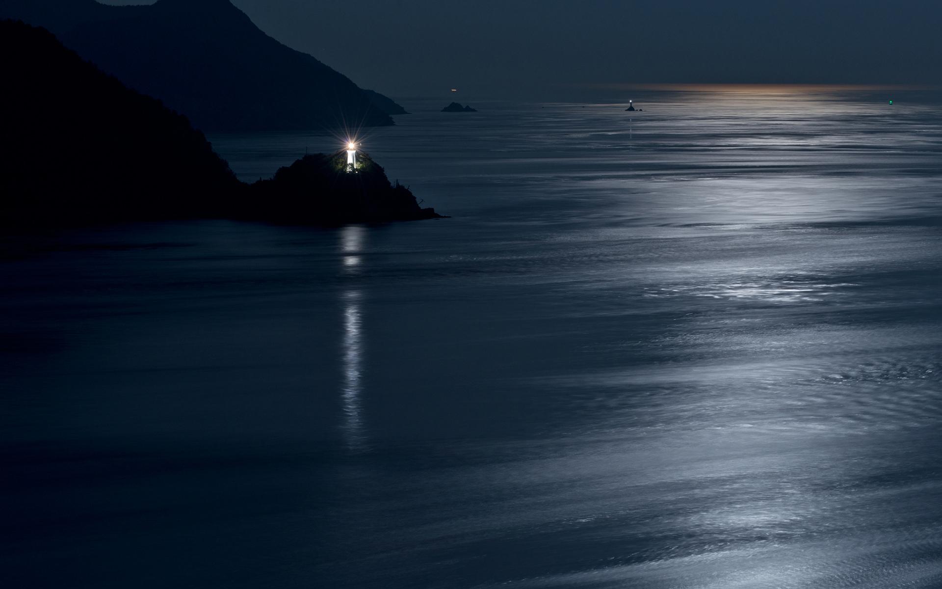 Lighthouse Coast night ocean sea reflection moon moonlight lights 1920x1200