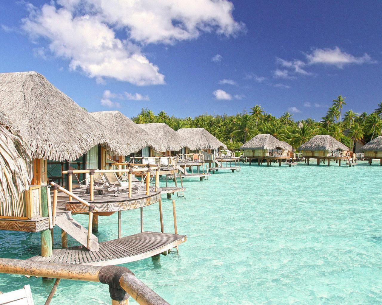 Bora bora water villas bungalows at pearl beach spa and resort 1280x1024