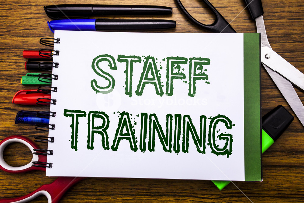 Conceptual hand writing text Staff Training Concept for Teaching 1000x667