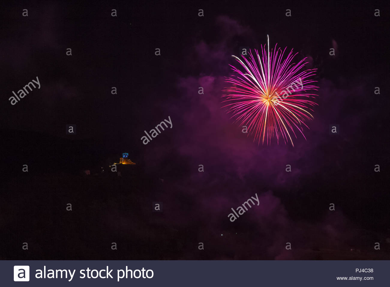 Violet fireworks with illuminated church of the patron saint of 1300x956