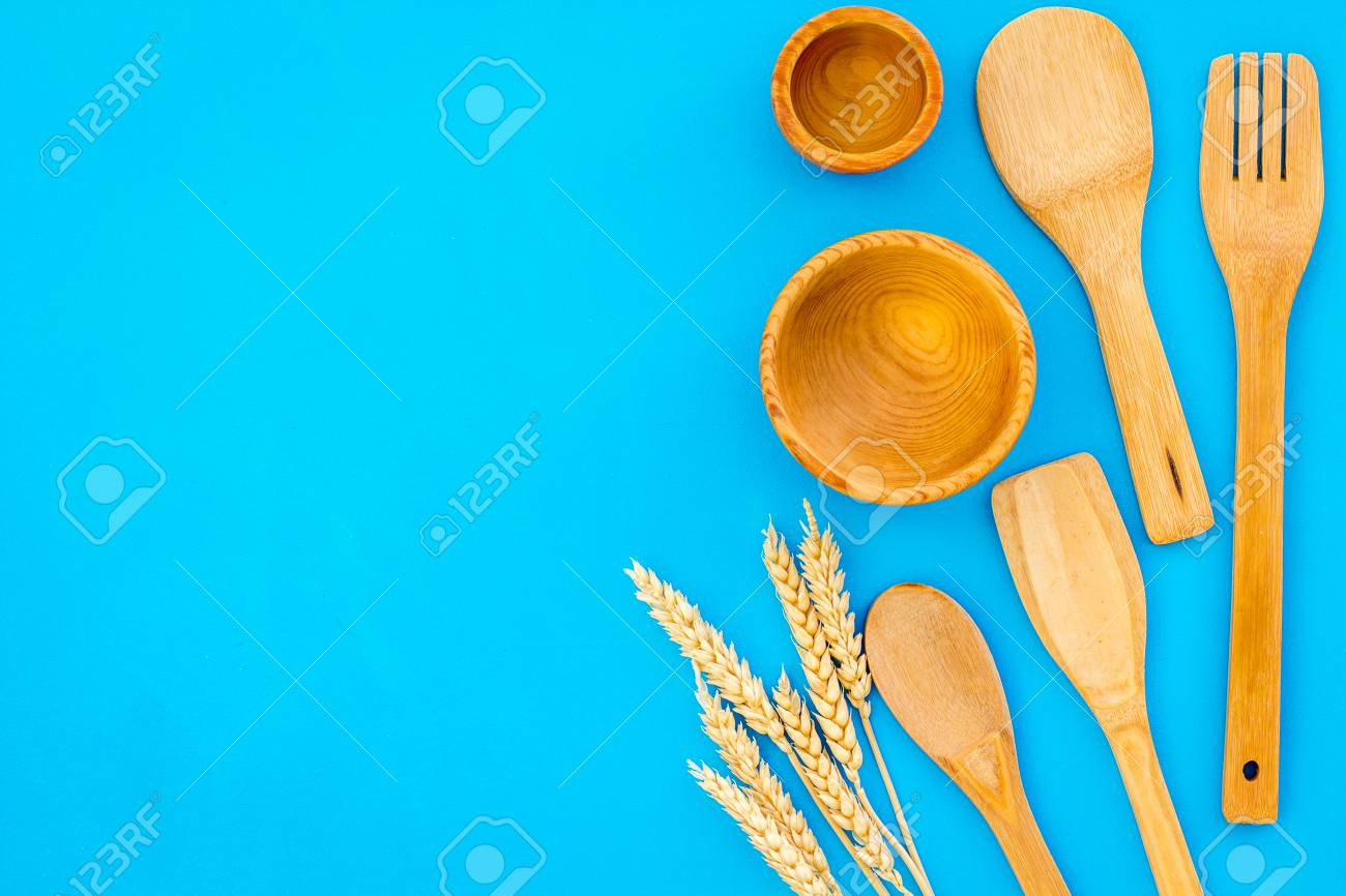 Village Wooden Cutlery Set On Blue Table Background Top View 1300x866