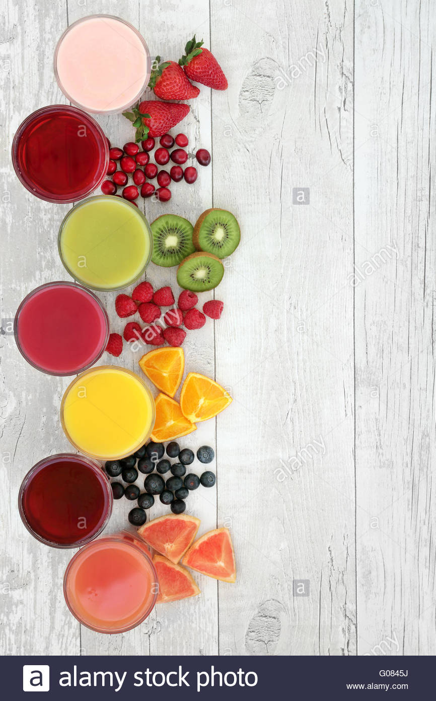 Healthy fresh fruit and juice smoothie drinks over distressed 866x1390