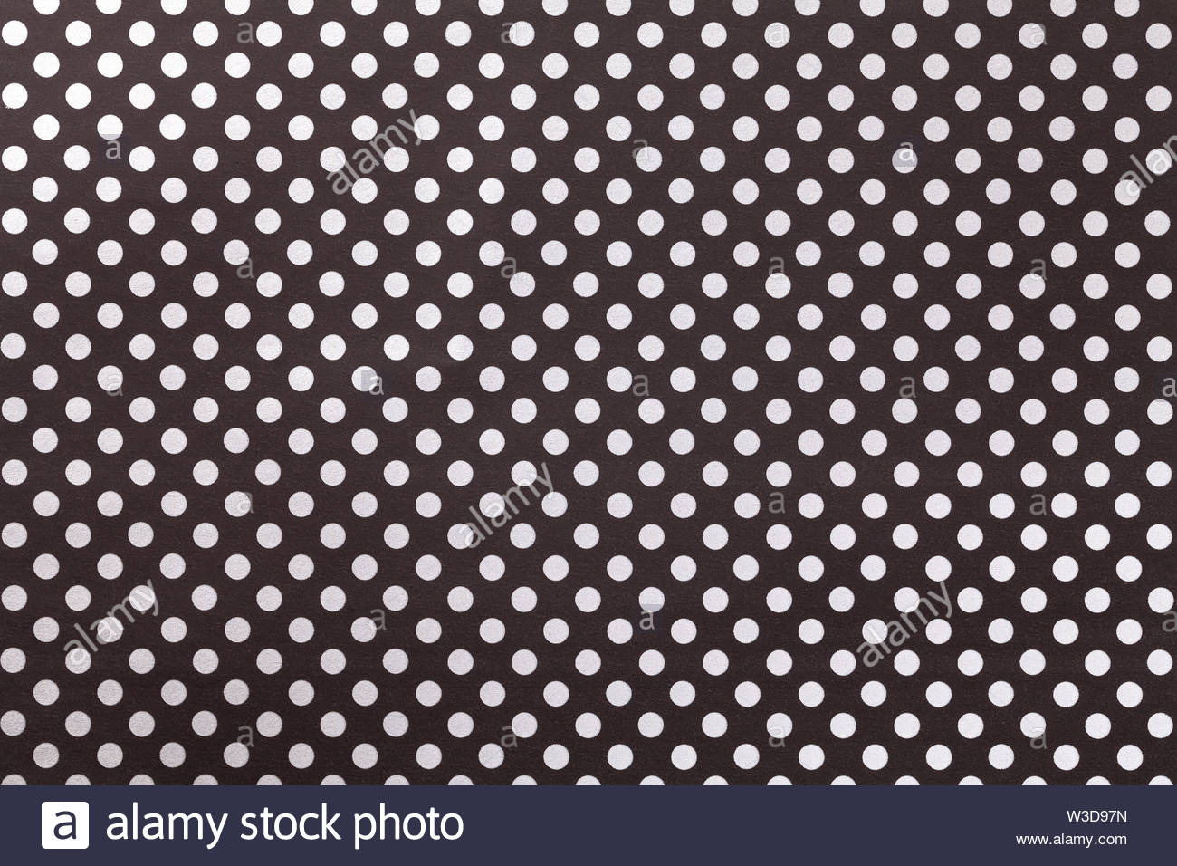 Black background from wrapping paper with a pattern of white polka 1300x956