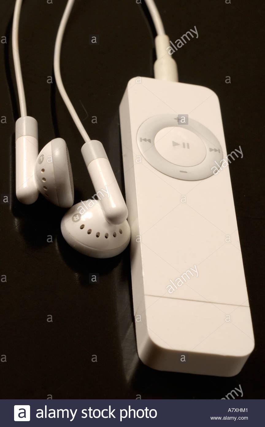 apple iPod shuffle with headphones on black background Stock Photo 864x1390