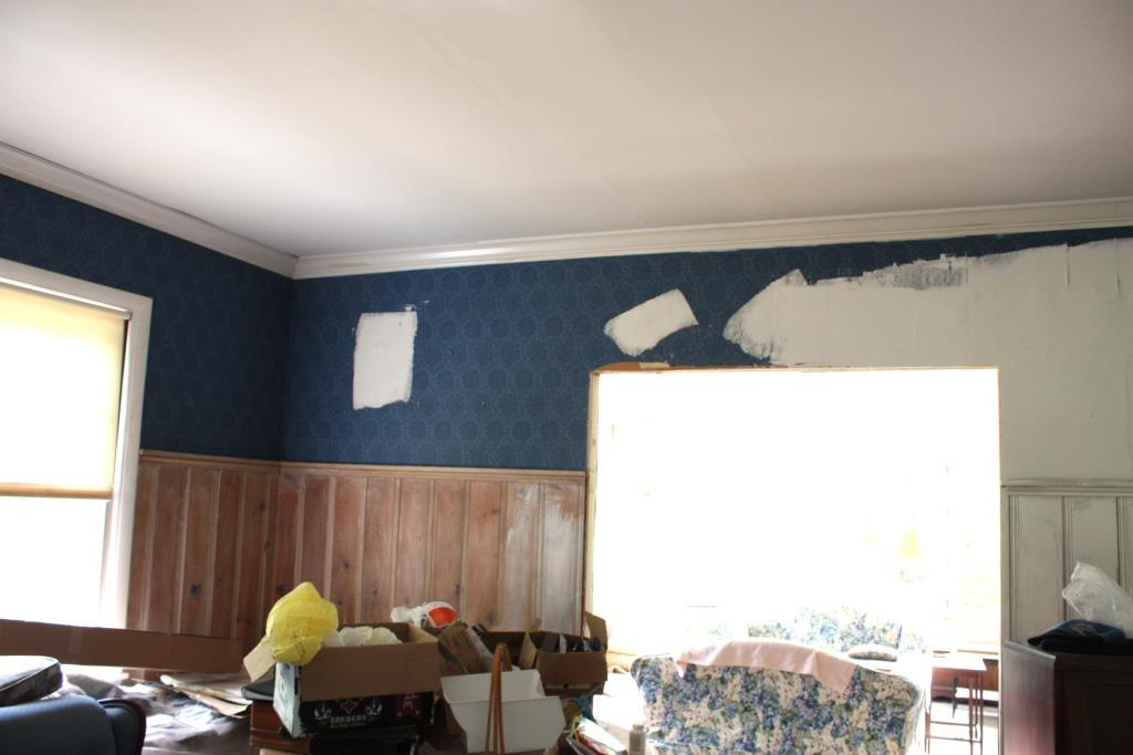 white area is drywall mud than had been applied over the wallpaper 1024x683