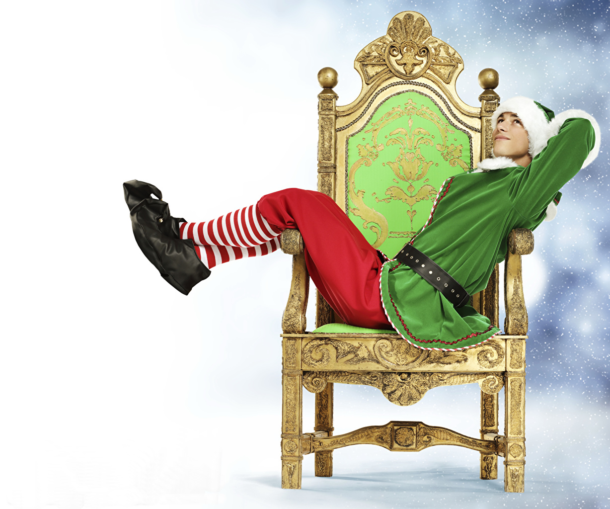 Wallpapers Elves New year Young man Legs Uniform Sitting Armchair 1228x1024