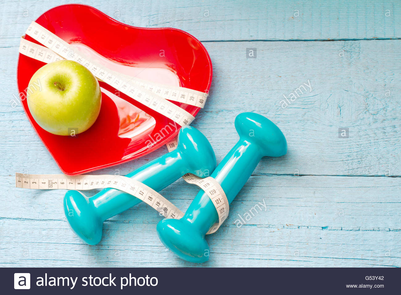 Fit and health abstract concept with red heart plate on wooden 1300x956