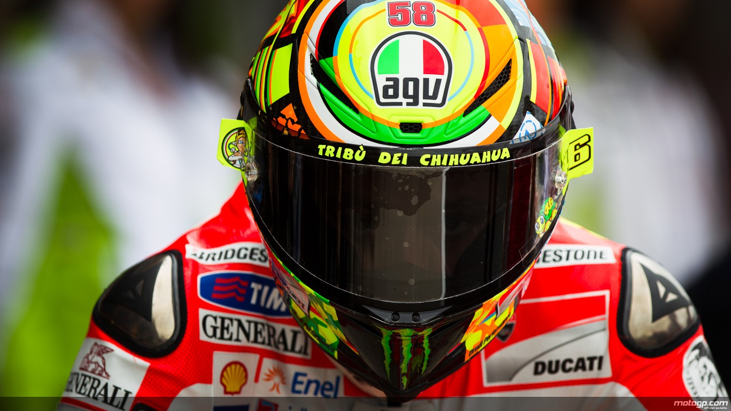 Wallpaper Valentino Rossi Ducati Team 2012 and make this wallpaper for 1440x810