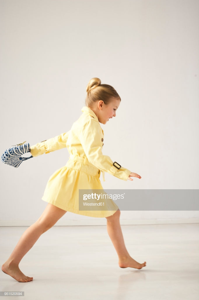 Laughing Little Girl Running Barefoot In Front Of Light Background 682x1024