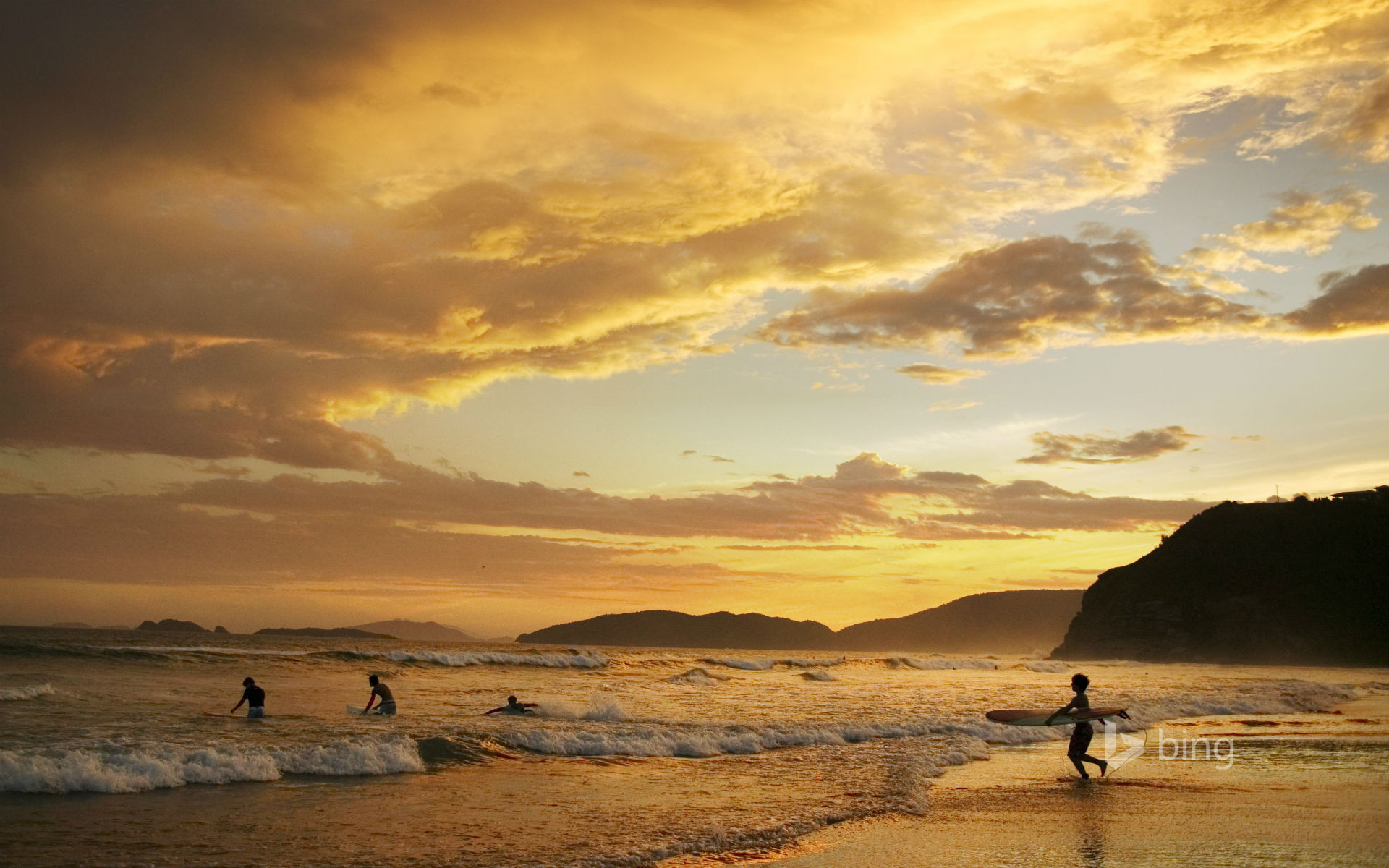 People surfing at dusk Geriba Beach Buzios Brazil Mark 1920x1200