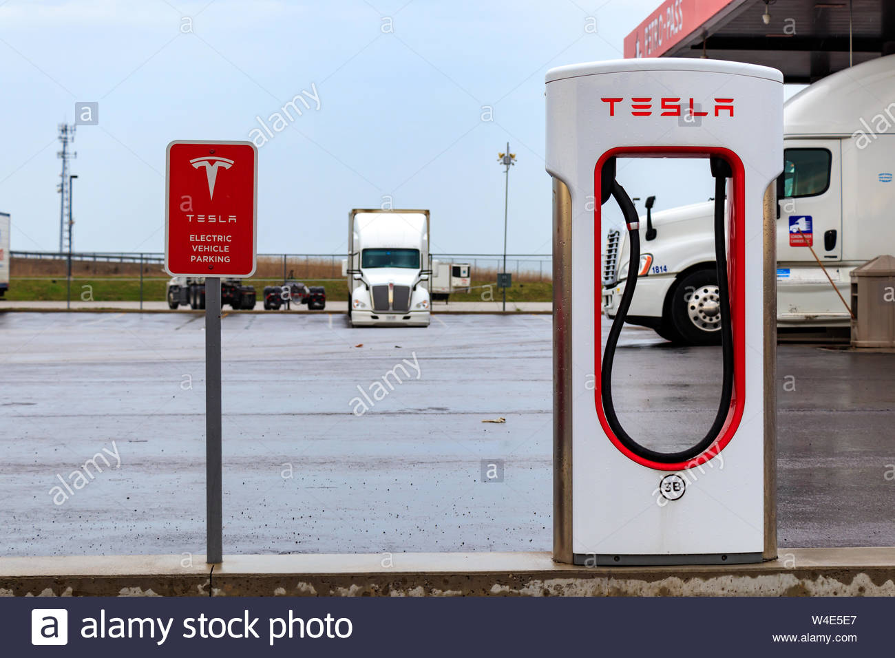Tesla Supercharger Stall and Tesla Electric Vehicle Only sign 1300x956