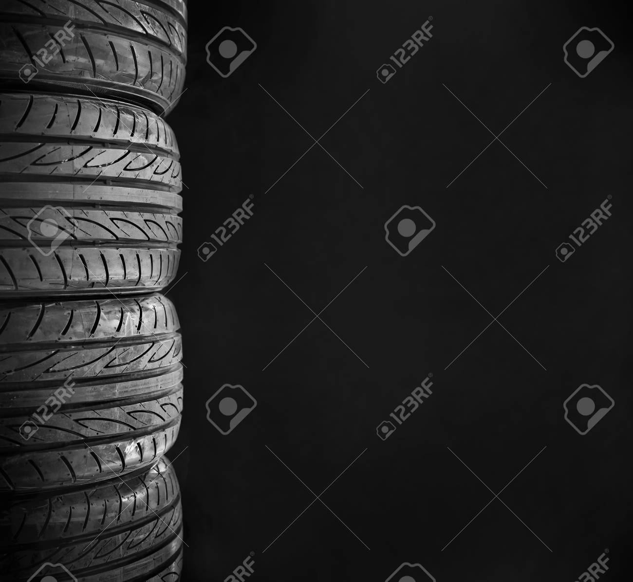Car Tires Isolated On Black Background Stock Photo Picture And 1300x1196