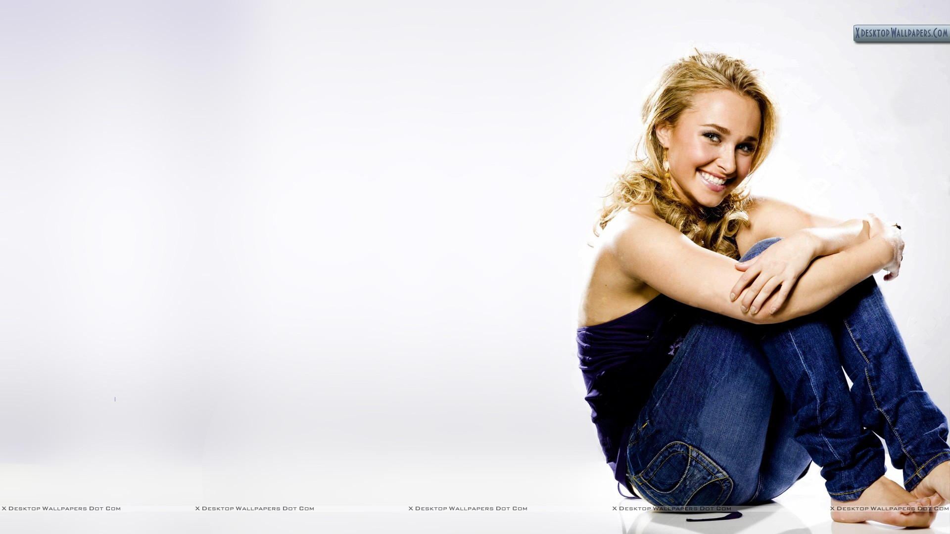 Hayden Panettiere Sitting In Blue Jeans And Top Wallpaper 1920x1080