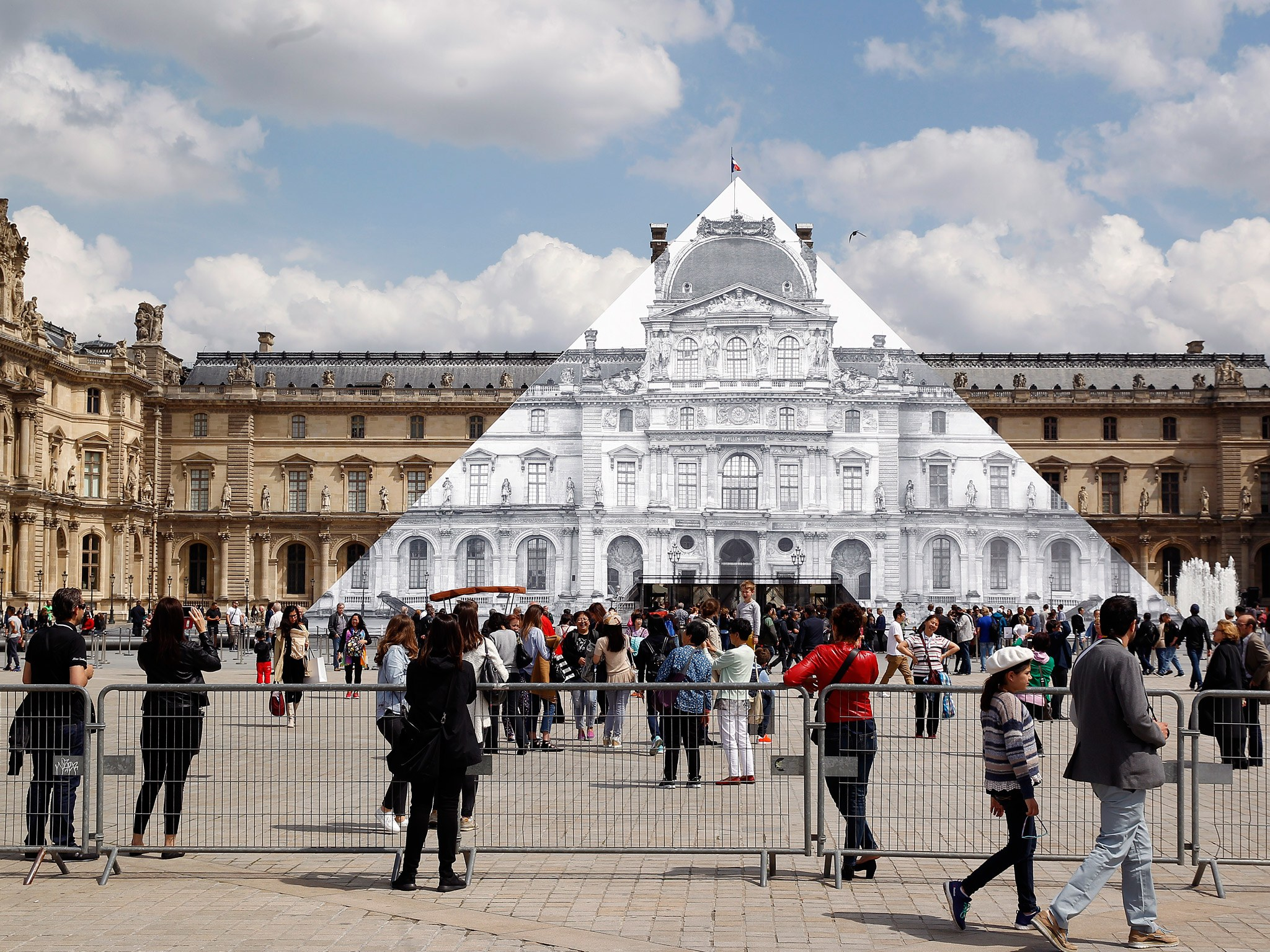 In Paris Artist JR Makes Louvre Pyramid Disappear   Cond Nast 2048x1536