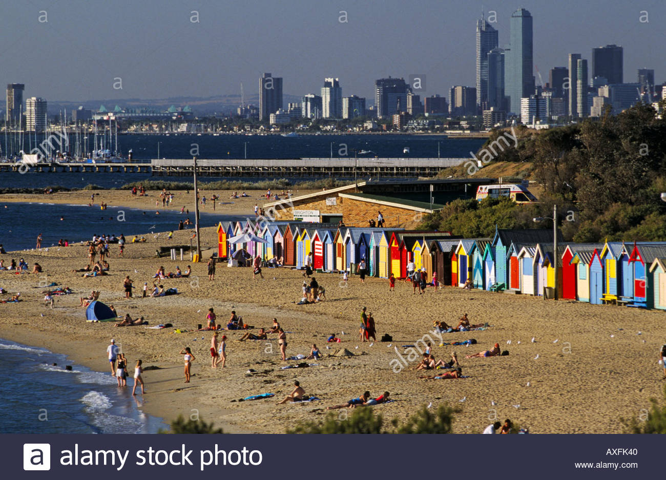 Beach boxes with city skyline in background Brighton Melbourne 1300x937