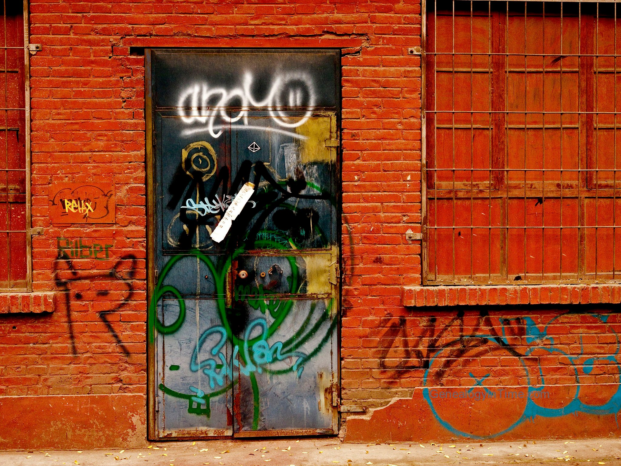 Graffiti door in brick wall 2048x1536
