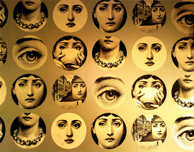 Fornasetti created nssmag Fornasetti plates accent this black and 640x503