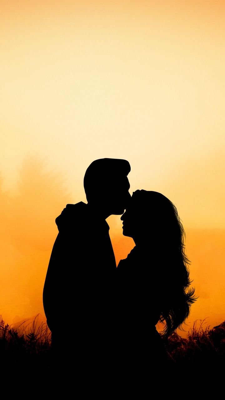 Couple hug kiss love outdoor sunset 720x1280 wallpaper 720x1280