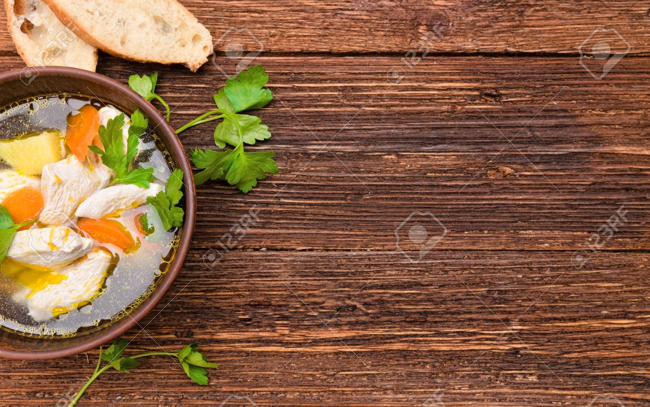 Soup With Chicken And Vegetables Background Stock Photo Picture 1300x814
