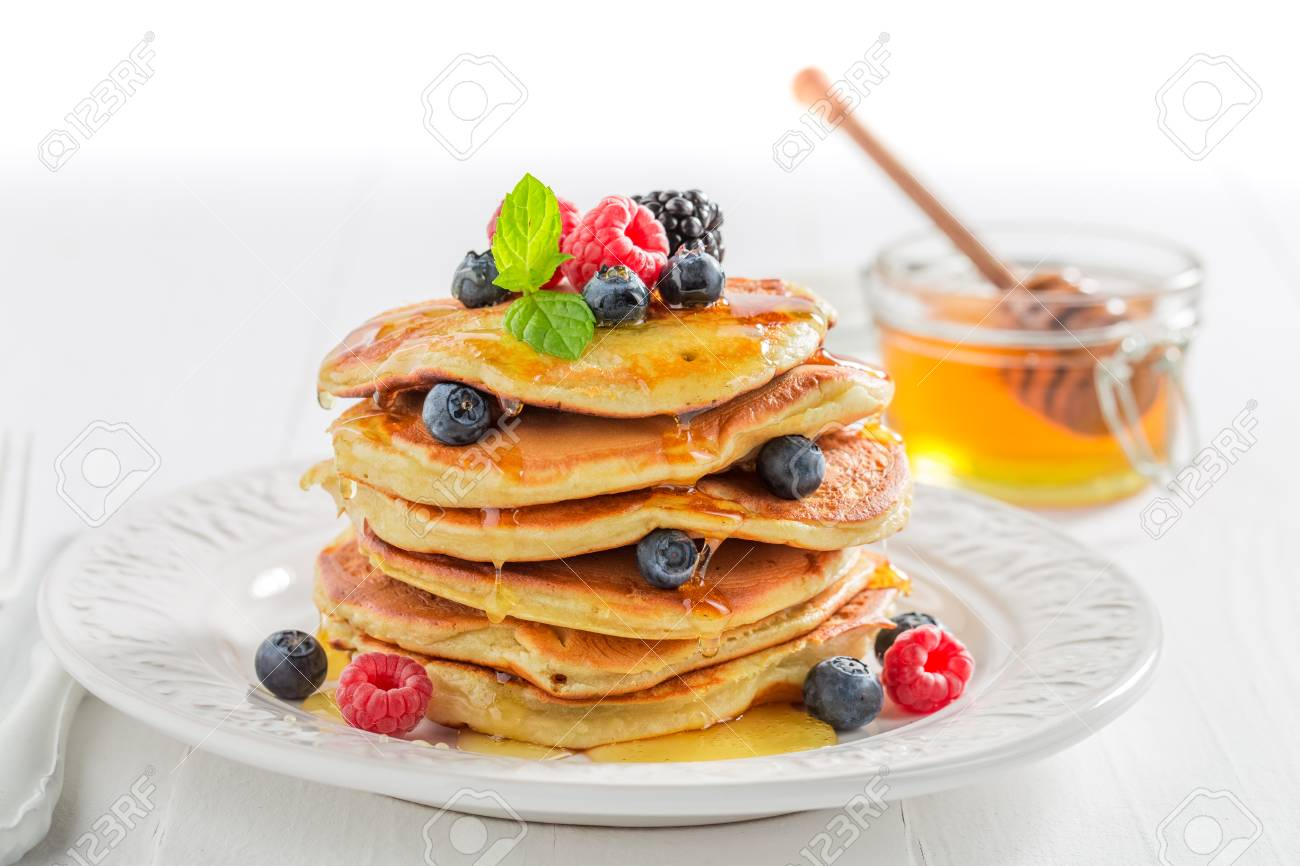 American Pancakes For Breakfast In The Morning On White Background 1300x866