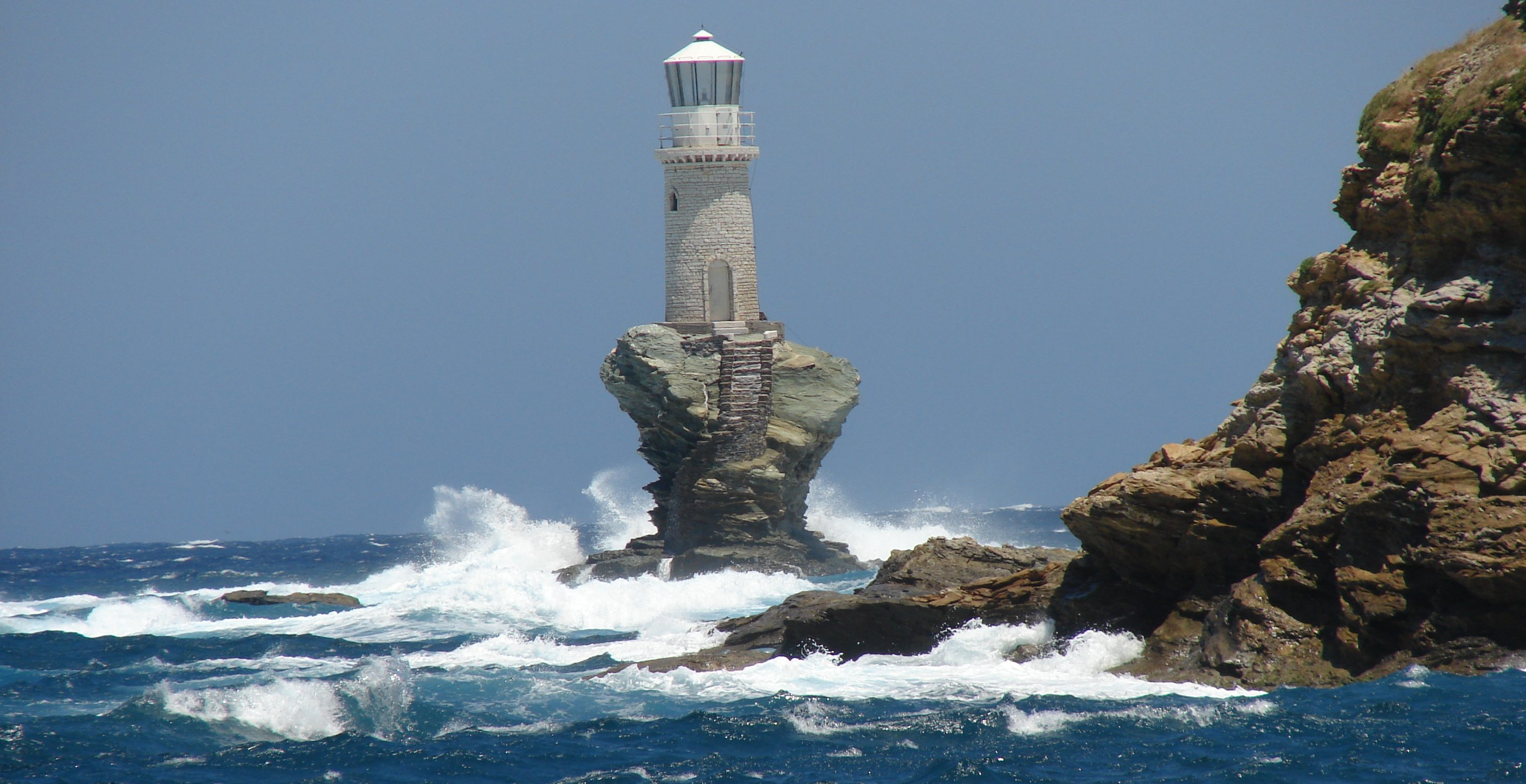 The lighthouse Tourlitis of Andros Island Greece was bulit in 2816x1448