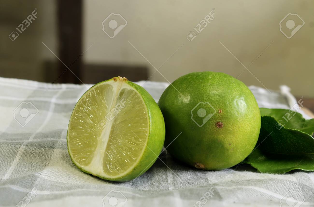 Two Limes On The Handkerchief Background Stock Photo Picture And 1300x859