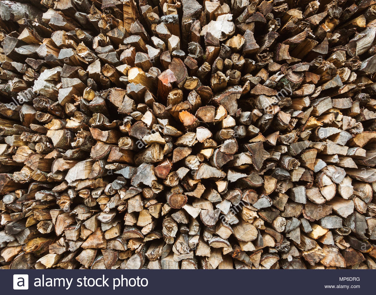 Stack of firewood chopped firewood background Stock Photo 1300x1018