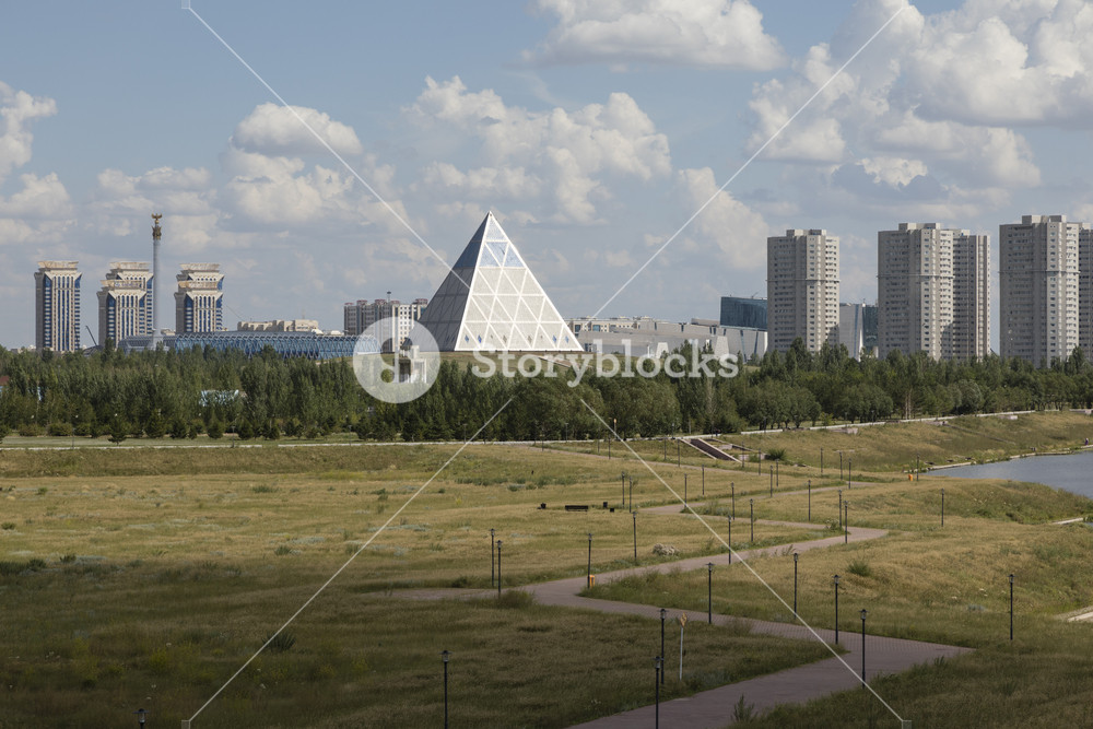 Shore of the Yesil River in Astana with the Palace of Peace and 1000x667