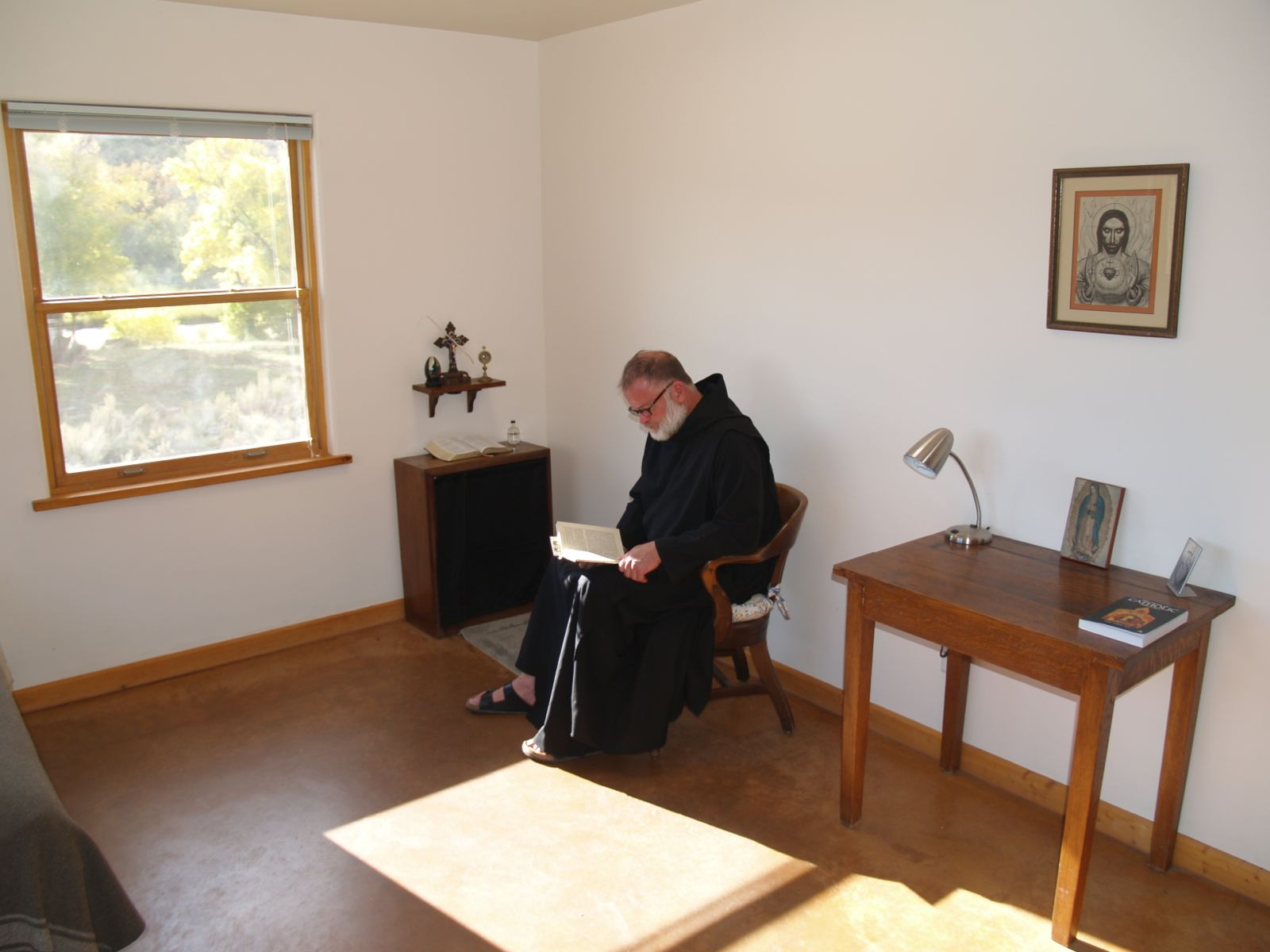A brother doing Lectio Divina in his cell   Benedictine Abbey of 1600x1200