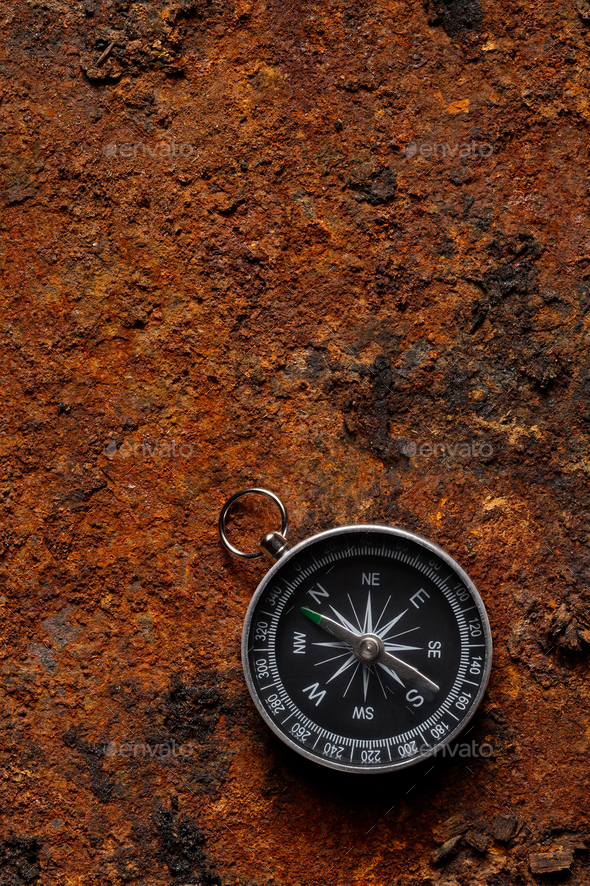 Magnetic compass on rough rusty background Stock Photo by 590x886