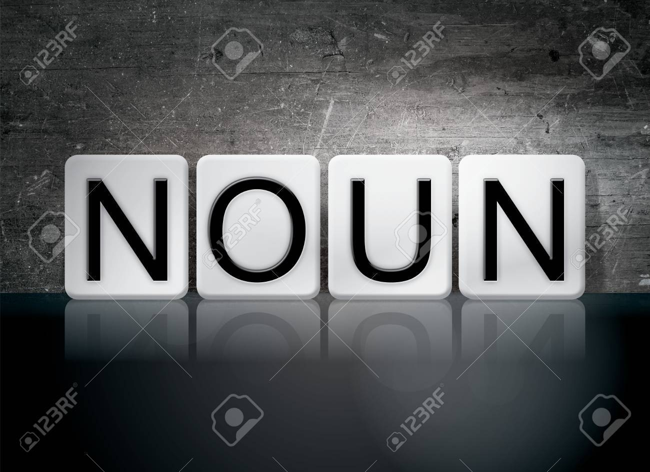 The Word Noun Written In White Tiles Against A Dark Vintage 1300x945