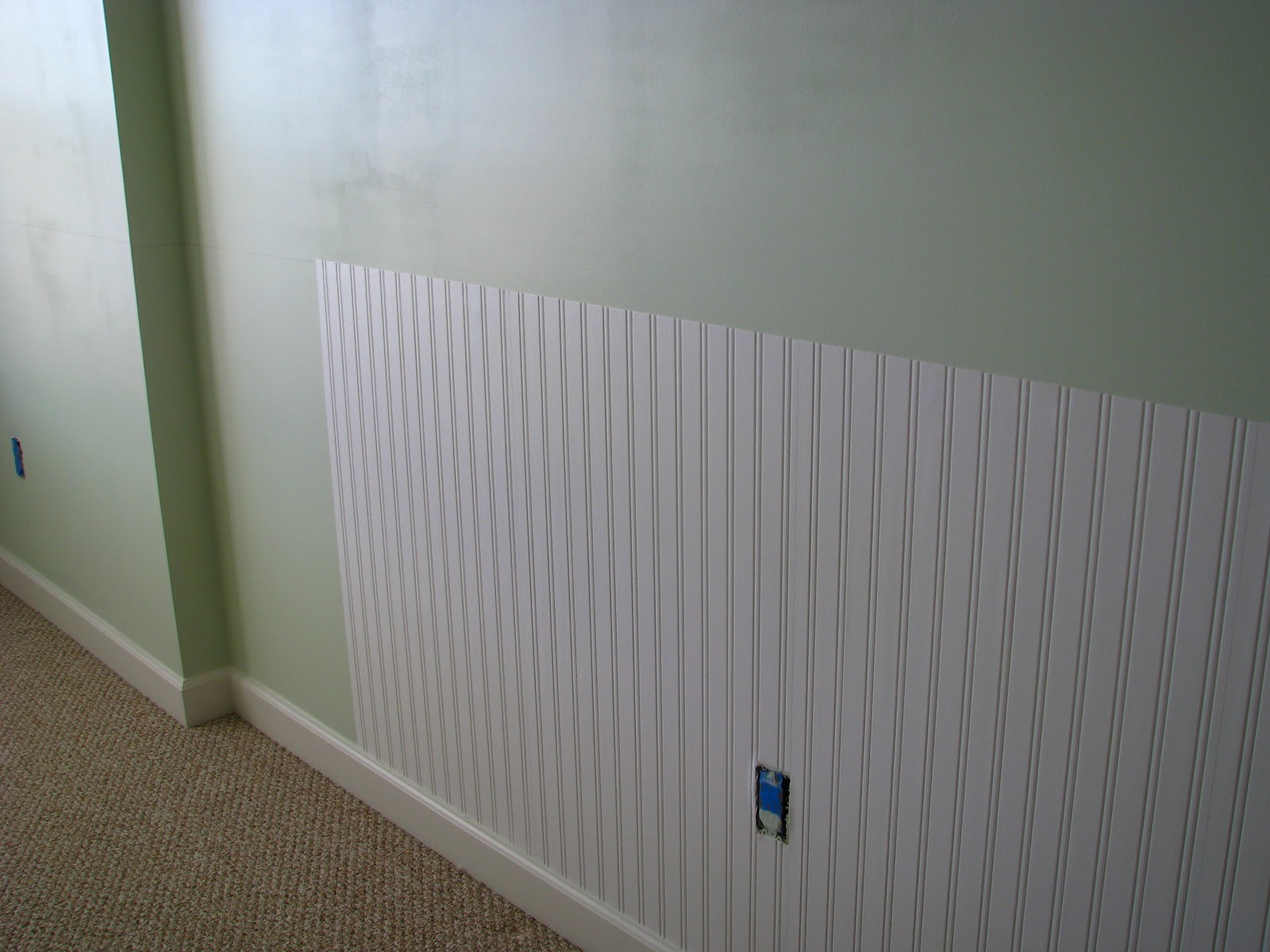 We painted the room a pale green and added beadboard wallpaper 1600x1200