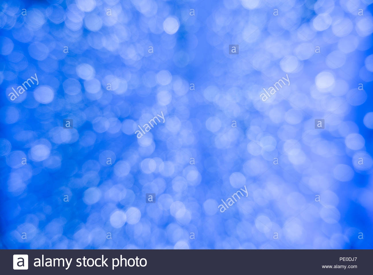 Abstract blue bokeh circles for Christmas background Royalty high 1300x956