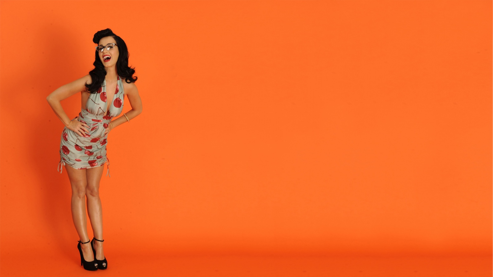 Katy Perry Orange Background Wallpapers   1600x900   168400 1600x900
